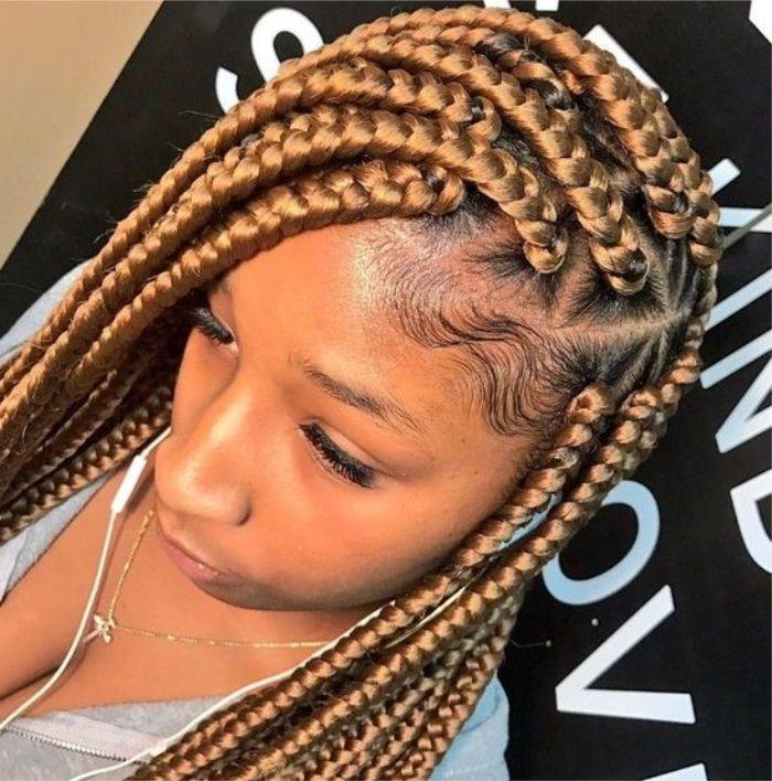 Penteados com tranças em cabelo afro.